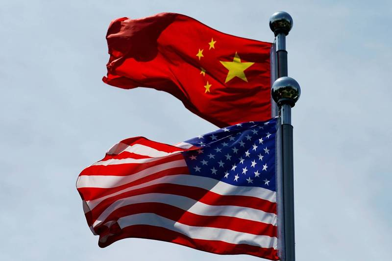 美國國旗與中國五星旗。(路透檔案照)