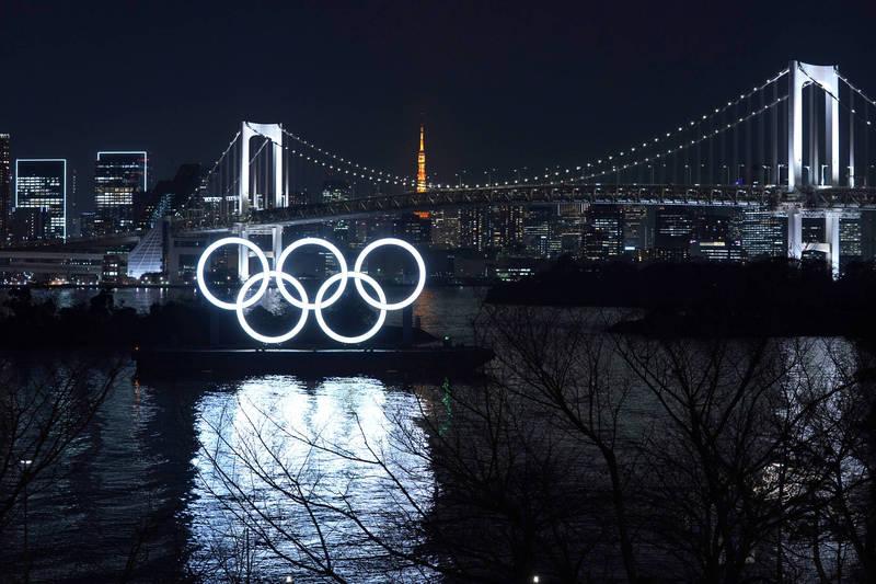 日本官方堅持舉辦東京奧運會。(彭博檔案照)