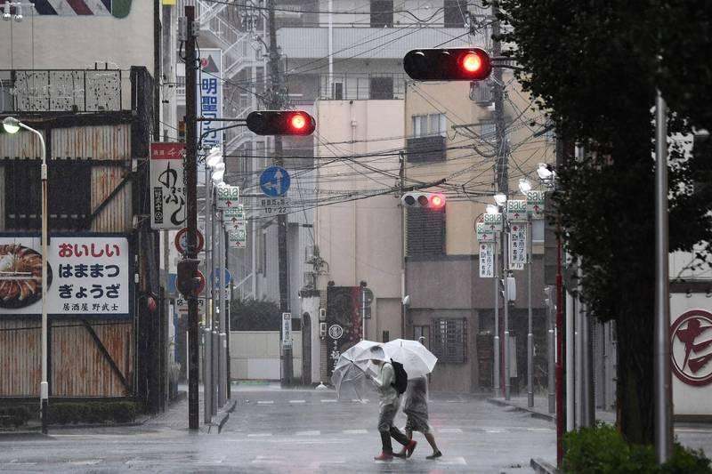 日本靜岡縣出現3例感染途徑不明的英國變種病毒病例。圖為靜岡縣街景,示意圖。(法新社)