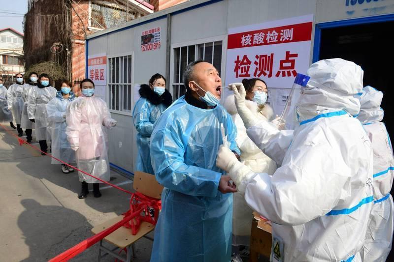 中國河北武漢肺炎疫情大爆發,當地部分地區為此進行全員普篩。(法新社)
