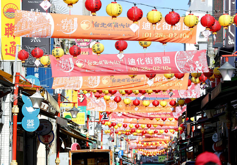 Banners and lanterns on Dihua Street in Taipei's Datong District yesterday announce the dates of the annual Lunar New Year market, which has been canceled. Photo: CNA