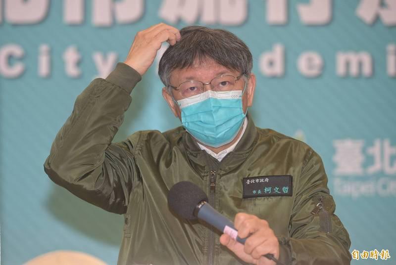 台北市長柯文哲表示,年貨大街實體活動取消、台北燈節延後舉辦,面對業者可能產生的損失,市府現在也在草擬北市相關的委辦合約都要有SOP,要想補償辦法。(記者張嘉明攝)