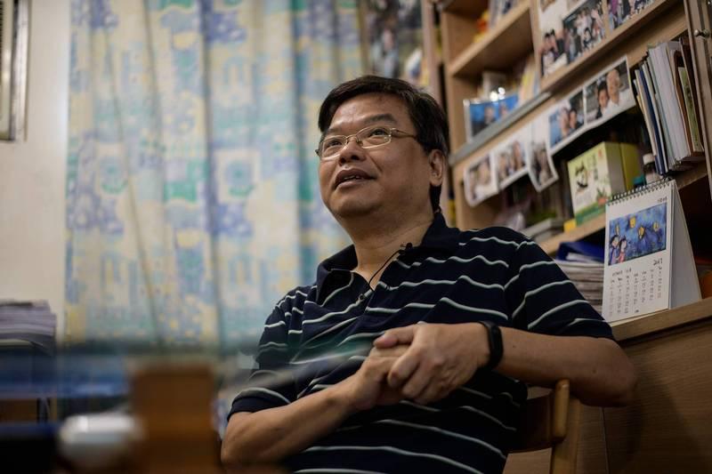 黃之鋒父親黃偉明和妻子及小兒子被爆出已離開香港,前往澳洲。(法新社)