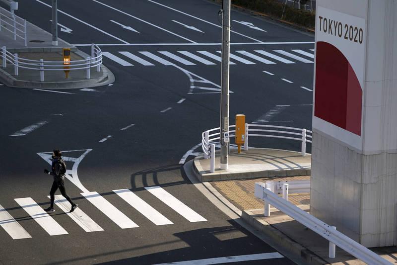 日本21日新增確診病例5653例、死亡病例94例。圖為東京街景。(美聯社)