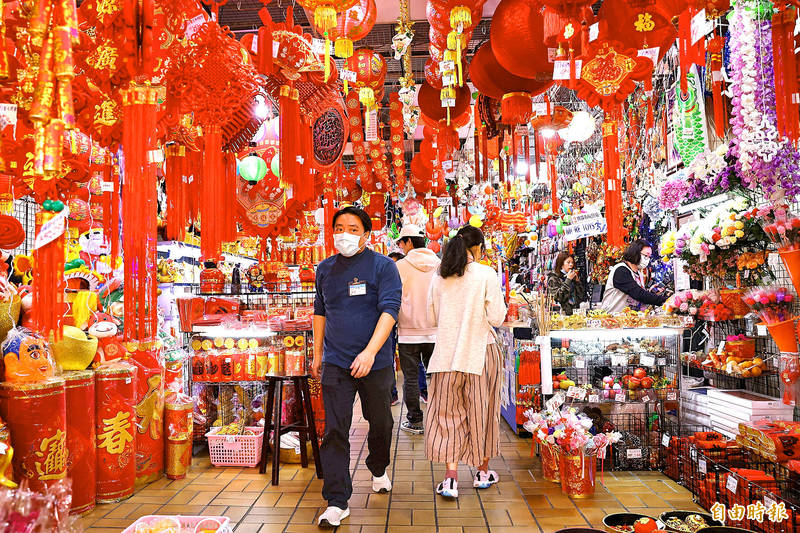 People walk through a shopping area selling decorations and supplies for the Lunar New Year holiday in Taipei on Wednesday last week. Photo: Ann Wang, Reuters