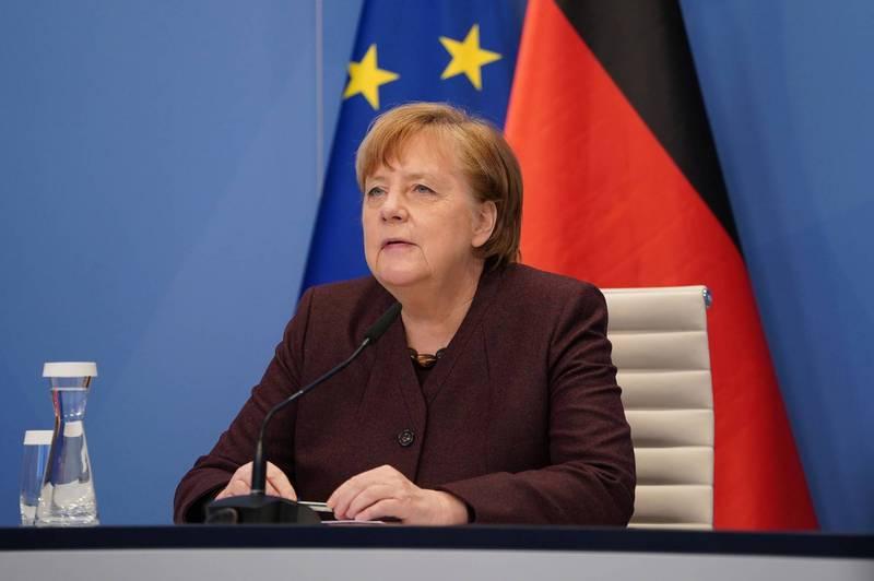 德國總理梅克爾26日在瑞士達沃斯(Davos)舉行的世界經濟論壇(WEF)上發言。(路透)