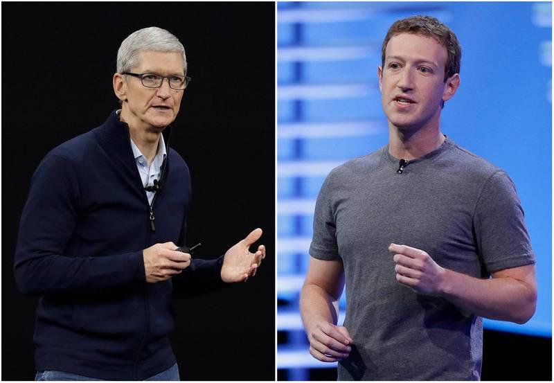 蘋果公司執行長庫克(左)今天暗批臉書的商業模式助長不實訊息與暴力,臉書執行長札克伯格(右)則表示,蘋果是臉書最大的競爭對手之一。另臉書準備對蘋果提反壟斷訴訟,兩大科技巨頭之間的夙怨再度加劇。(美聯社)