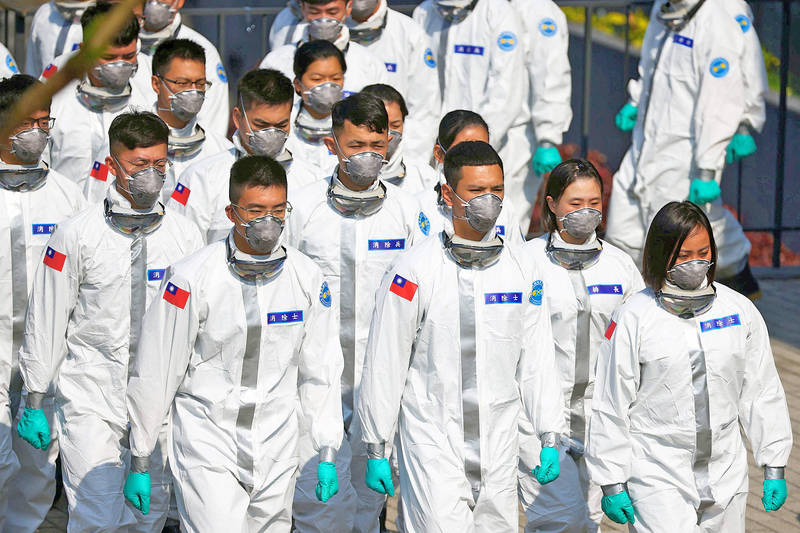 Soldiers from the 6th Army Command 33rd Chemical Corps and workers from the Taoyuan City Government Epidemic Prevention and Sterilization Squad prepare for a visit by President Tsai Ing-wen yesterday in Taoyuan. Photo: Ann Wang, Reuters