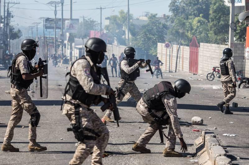 海地當局7日宣布攻破反對派政變計畫,逮捕包括最高法院法官、高階警官在內的23人。圖為海地首都太子港示威。(法新社)