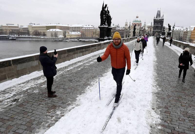 Czech people skiing on the Charles Bridge in Prague.  (Reuters)