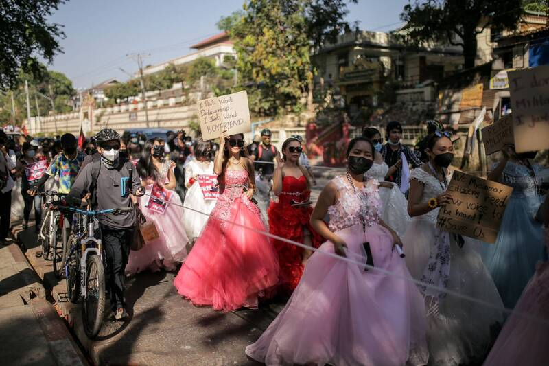 Female demonstrators took to the streets in their formal dresses to protest. One of them had a slogan that read,