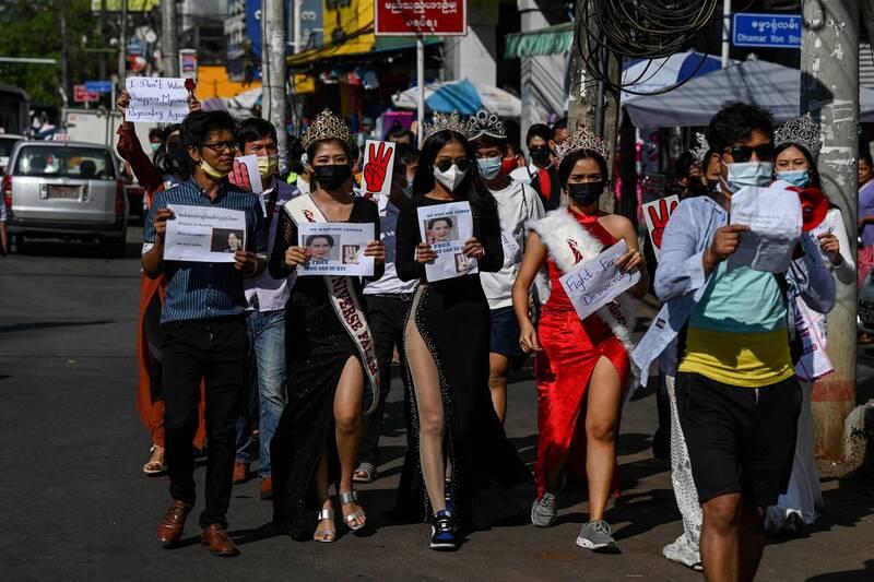 Burmese demonstrator dressed as a beauty queen.  (AFP)