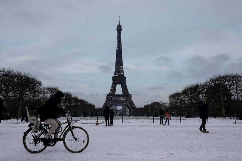 In the snow-covered French capital, the Eiffel Tower was also frozen.  (AFP)