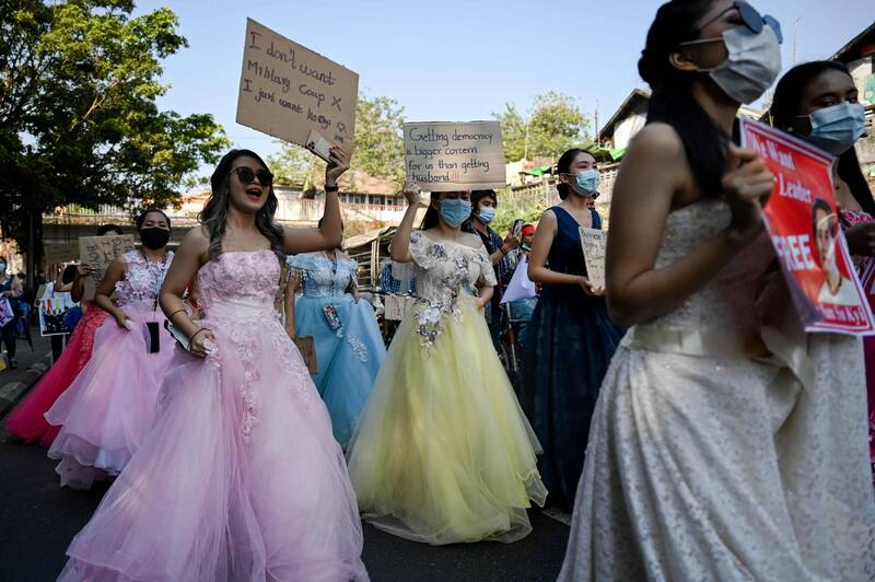 Many demonstrators took to the streets wearing eye-catching costumes, dressed as princesses.  (AFP)