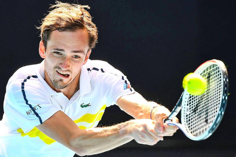 Russia's Daniil Medvedev returns to Filip Krajinovic of Serbia in their Australian Open men's singles match in Melbourne yesterday. Photo: AFP