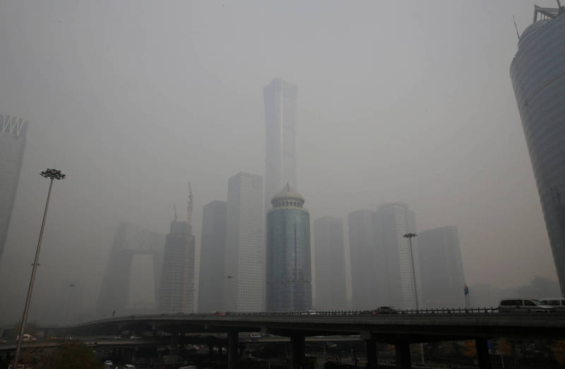 Affected by weather conditions and firecrackers in northern China, severe haze occurred during the Spring Festival. The picture shows a schematic diagram of the haze damage in Beijing.  (Photo by Reuters)
