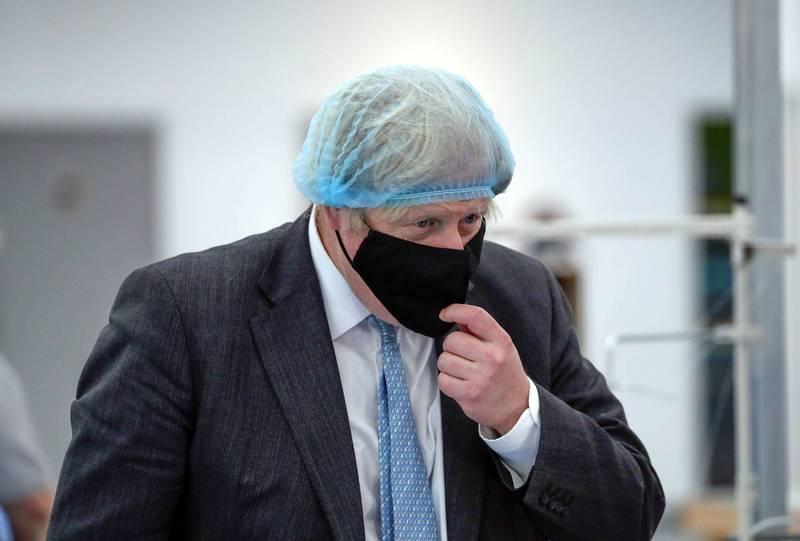 英國首相強森表示,目標在3月8日重新開放學校。(資料照,路透)