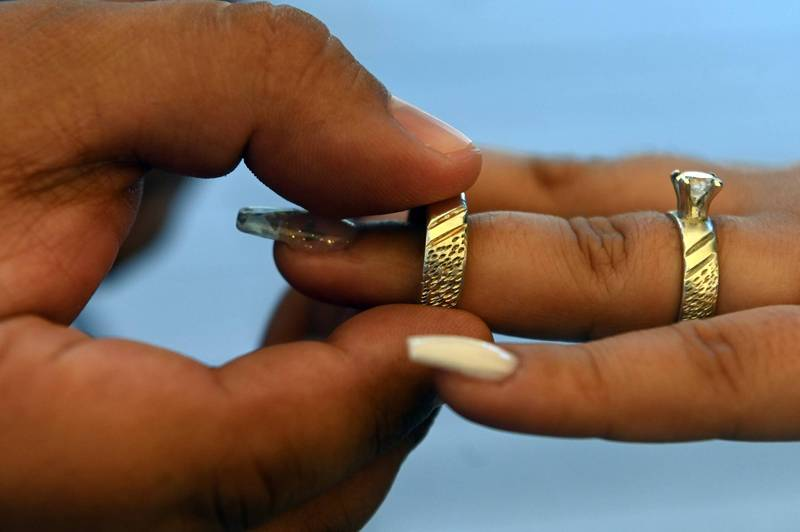 Davis, an American man, used a pseudonym to date two women and stole one of the wedding rings to propose to the other. Schematic.  (AFP)