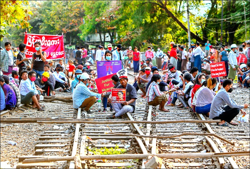 Demonstrators in Mandalay sat in a sit-in on a railway, obstructing railway transportation.  (Associated Press)