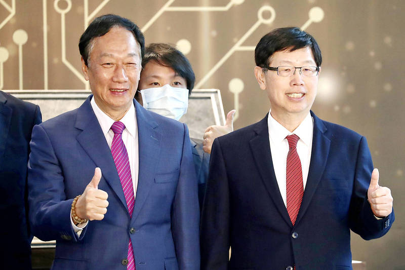 Former Hon Hai Precision Industry Co founder and chairman Terry Gou, left, and current chairman Young Liu pose for a photograph at the opening of the Hon Hai Research Institute in Taipei on Jan. 4. Photo: Ritchie B. Tongo, EPA-EFE