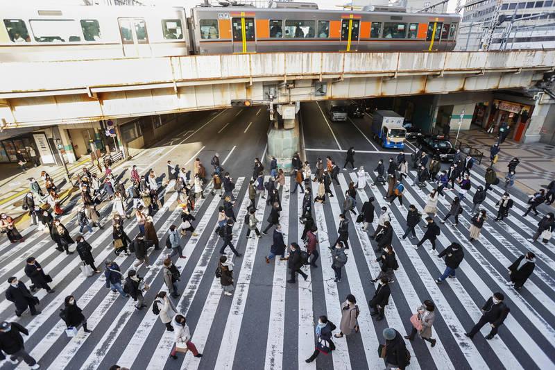 日本19日新增1303例確診、66例死亡。圖為大阪街景。(美聯社)