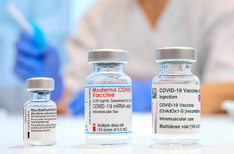 From left, used vaccine vials that contained Pfizer-BioNTech, Moderna and AstraZeneca COVID-19 vaccines are pictured at the Skane University Hospital vaccination center in Malmo, Sweden, on Wednesday last week. Photo: AFP