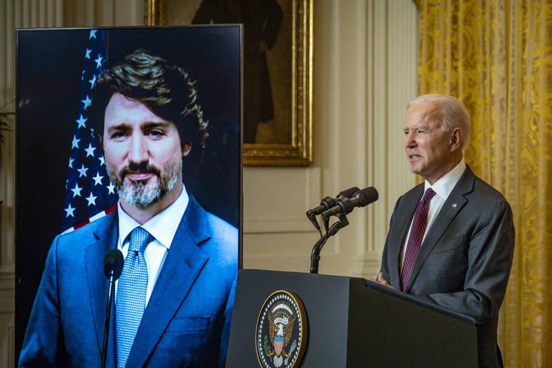 美國總統拜登(右)與加拿大總理杜魯道今日舉行雙邊線上會議。(歐新社)