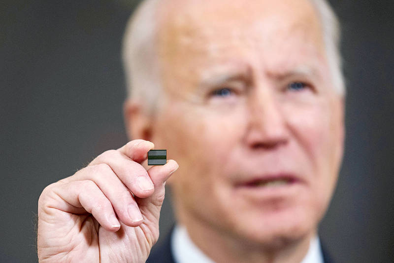 US President Joe Biden holds up a semiconductor before signing an executive order in the State Dining Room of the White House in Washington on Wednesday. Photo: Bloomberg