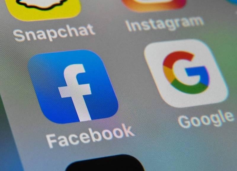 澳洲國會25日通過「新聞媒體與數位平台強制議價法」(News Media and Digital Platforms Mandatory Bargaining Code),要求Google和臉書等全球數位平台必須為澳洲產製的新聞內容付費。(法新社資料照)