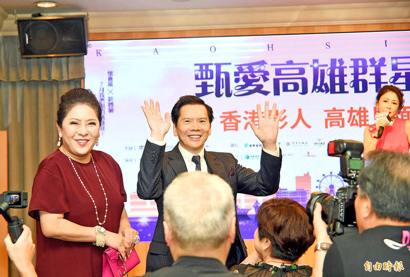 Hong Kong entertainment tycoon Charles Heung, center, and his wife, Tiffany Chan, left, attend an exhibition in Kaohsiung on July 12, 2019. Photo: Chang Chung-yi, Taipei Times