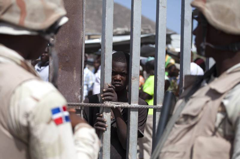 The border between Dominican Republic and Haiti already has some basic fences.  (Associated Press information photo)