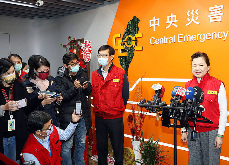 Minister of Economic Affairs Wang Mei-hua, right, speaks to reporters after a meeting at the Central Emergency Operation Center in Taipei yesterday. Photo: CNA