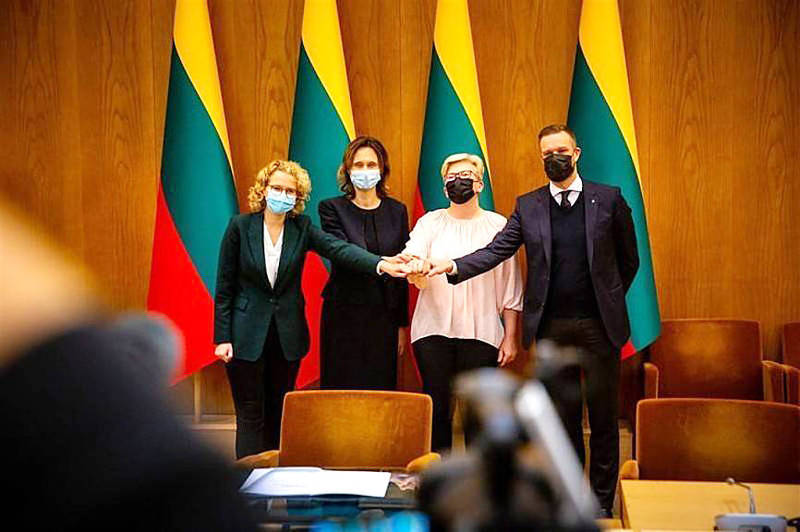 Leaders of Lithuania's ruling coalition pose for photographers on Nov. 9 last year. Photo: Screen grab from Facebook