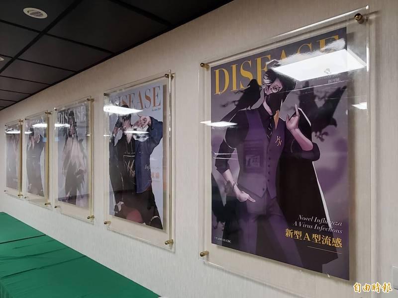 原本指揮中心貼滿江宏傑擔任防疫大使海報的牆面,如今已被疾病擬人化系列取代。(記者林惠琴攝)
