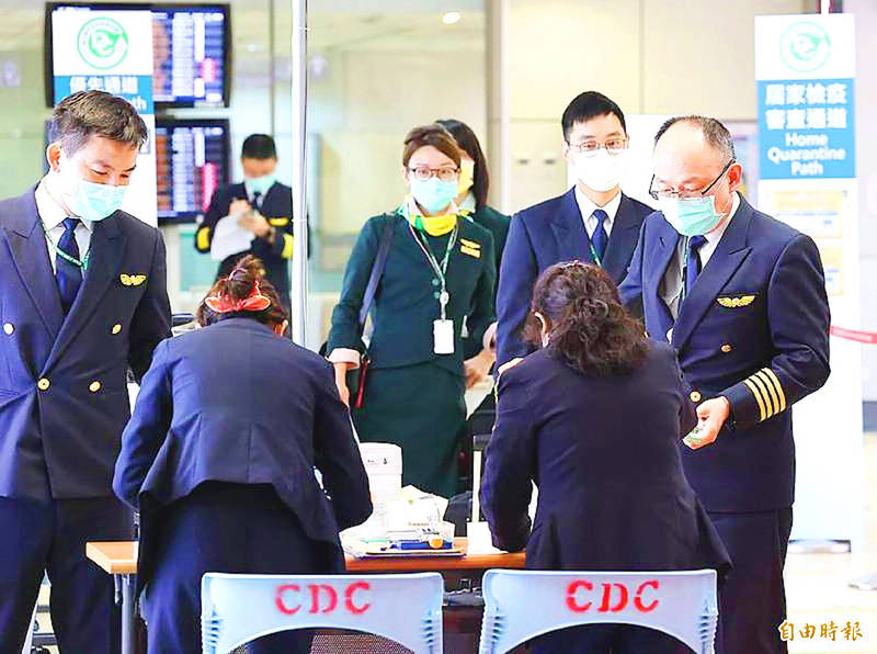 An airline crew arrives at a testing station operated by the Centers for Disease Control at Taiwan Taoyuan International Airport in an undated photograph. Photo: Cheng Wei-chi, Taipei Times