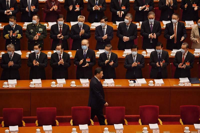 中國週五召開全國人民代表大會並公布一份發展路線圖,外媒分成四大面向分析。(法新社)