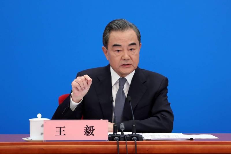 王毅在中國全國人代記者會中表示,外國媒體只要真實、客觀、公正,不需美顏相機,報導就會精采豐富。(路透)