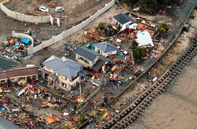311東日本大地震至今已過10年,重建之路仍未走完。圖為2011年3月福島縣磐城市受災情況一景。(歐新社)