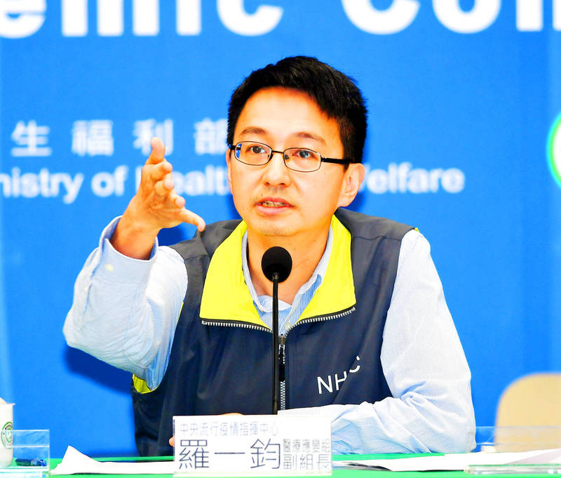 Centers for Disease Control Deputy Director-General Philip Lo reports on the COVID-19 situation at the Central Epidemic Command Center in Taipei yesterday. Photo: CNA