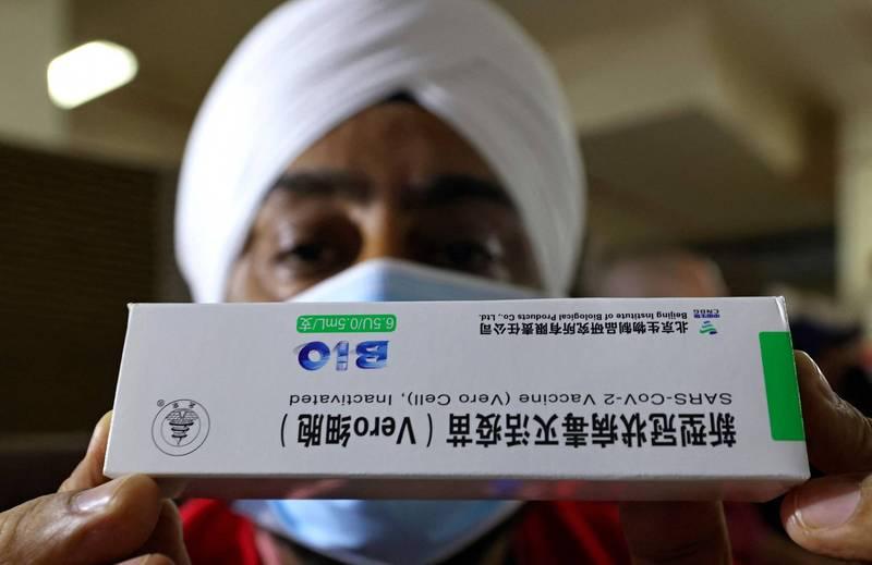 在科興與國藥拿出更全面的數據之前,世衛無法讓兩種疫苗進入緊急使用名單。(法新社資料照)