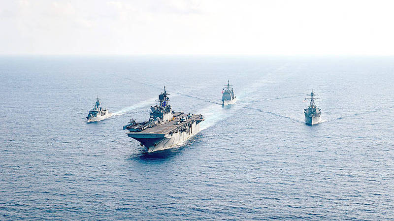 From left, Royal Australian Navy guided-missile frigate the HMAS Parramatta sails alongside the USS America, the USS Bunker Hill and the USS Barry in the South China Sea on April 18 last year. Photo: Reuters