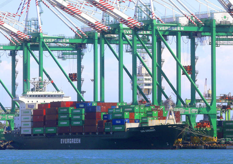 An Evergreen cargo ship is moored in a port in an undated photograph. Photo: CNA
