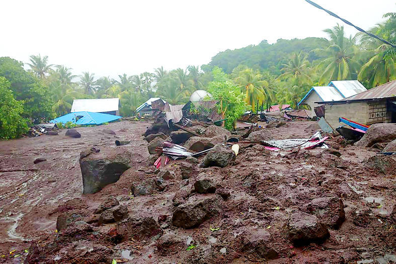 The aftermath of a flash flood in the village of Lamanele, Indonesia, yesterday. Photo: AFP / Indonesian National Board for Disaster Management (BNPB)
