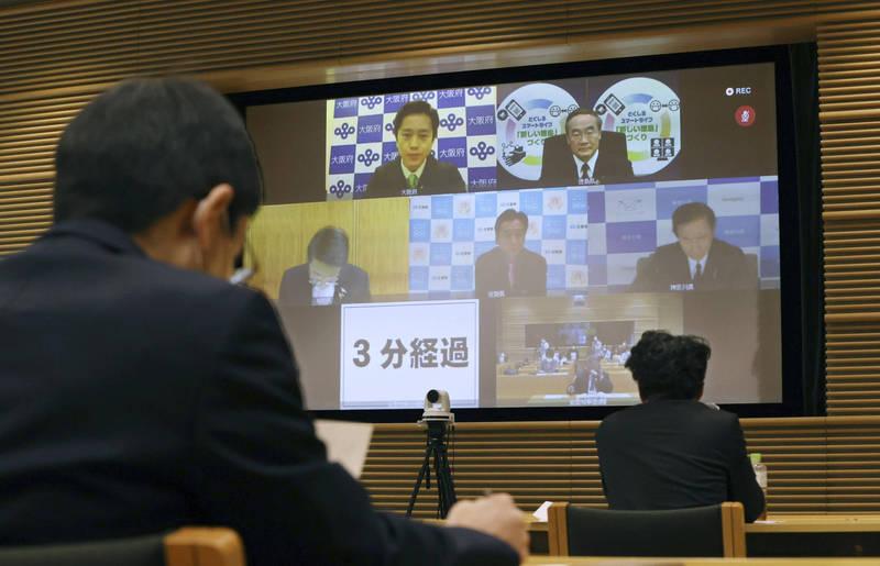 日本上月解除針對武漢肺炎(新型冠狀病毒病,COVID-19)的緊急事態宣言後,大阪疫情越來越嚴重,今日當地新增719例確診,創下疫情以來最高紀錄。(美聯社)