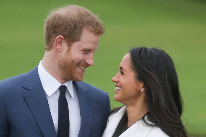 英國王室傳記作家莫頓(Andrew Morton)近日爆料,梅根與哈利結婚後,並未被王室強迫放棄演藝工作。(法新社)