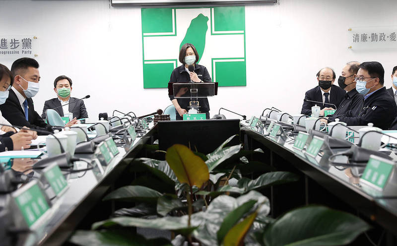 President Tsai Ing-wen, center, speaks at a Democratic Progressive Party Central Standing Committee meeting in Taipei yesterday, in her role as party chairperson. Photo: CNA