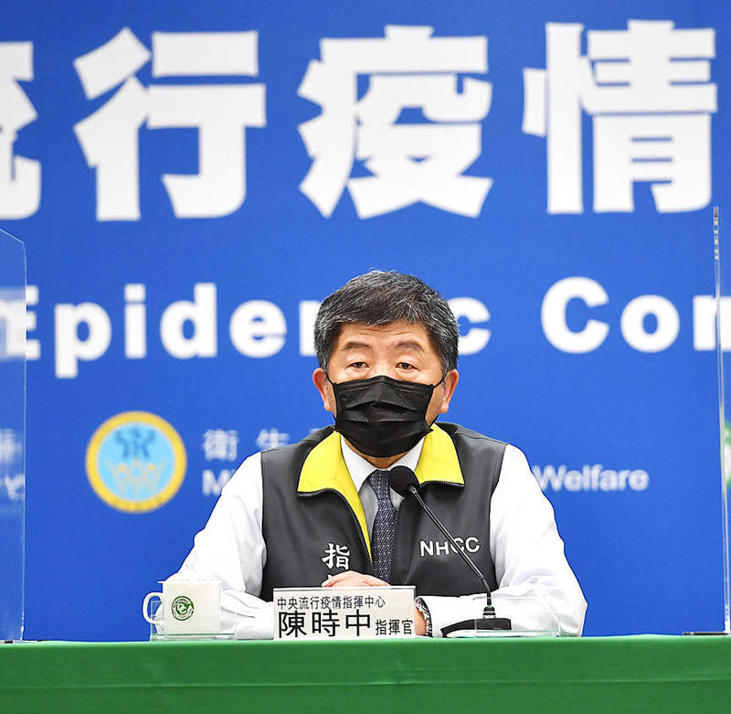 Minister of Health and Welfare Chen Shih-chung takes part in a news conference at the Central Epidemic Command Center in Taipei yesterday. Photo: CNA