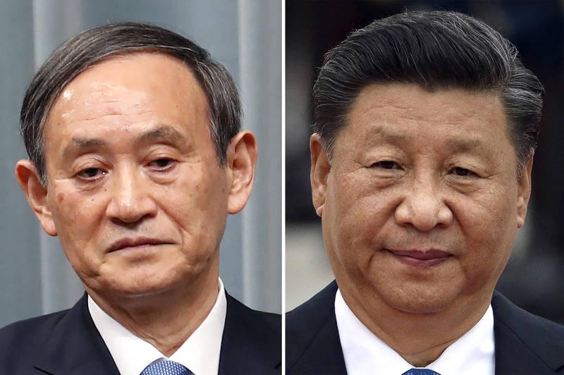 日相菅義偉(左)與中國領導人習近平。(美聯社)
