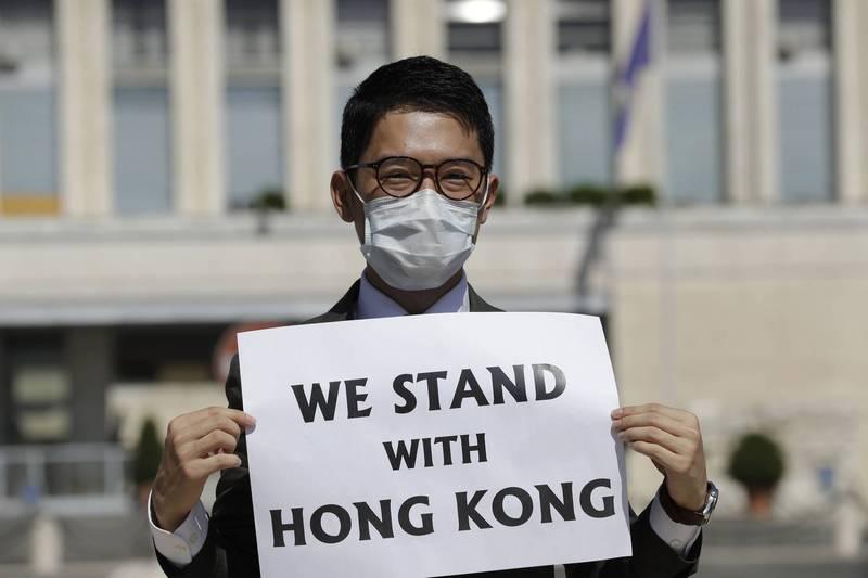 2020年8月,羅冠聰在羅馬抗議中國外交部長王毅訪問義大利。(美聯社檔案照)