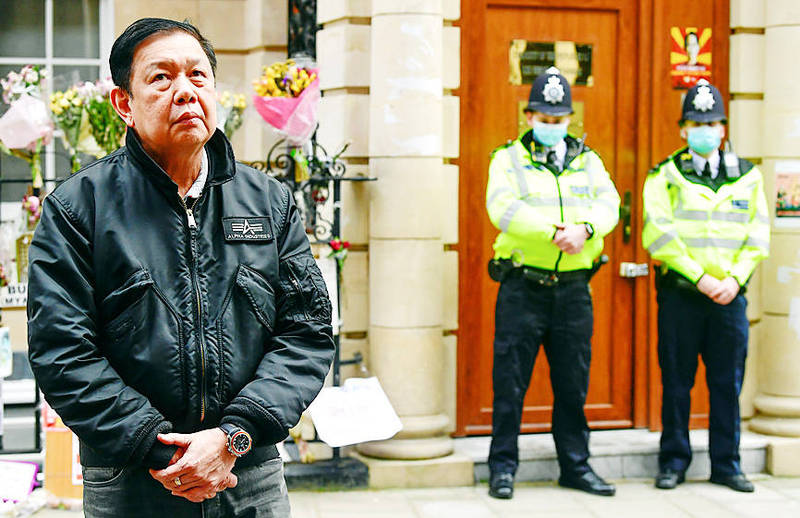 Burmese Ambassador to London Kyaw Zwar Minn stands outside the Burmese embassy in London yesterday after being locked out. Photo: Reuters